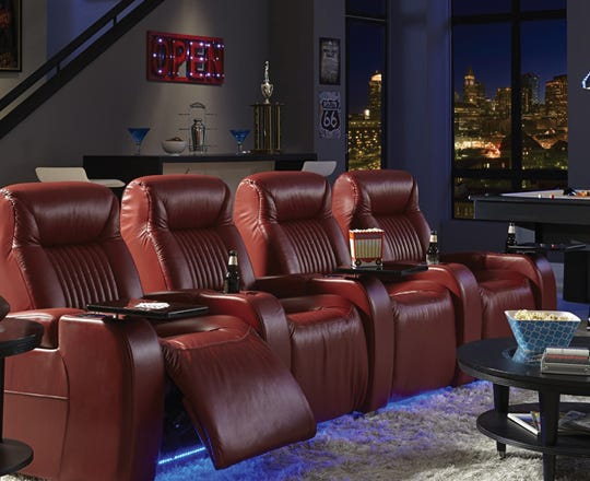 Red leather theater seating in a media room
