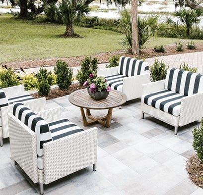 Outdoor patio furniture set in a backyard