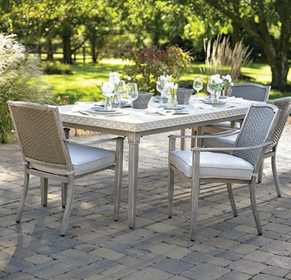 Outdoor dining set on a brick patio