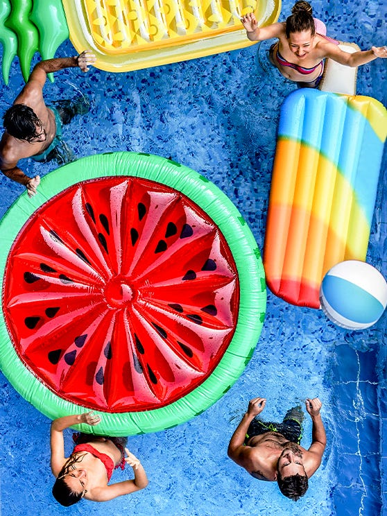 People in pool with floats