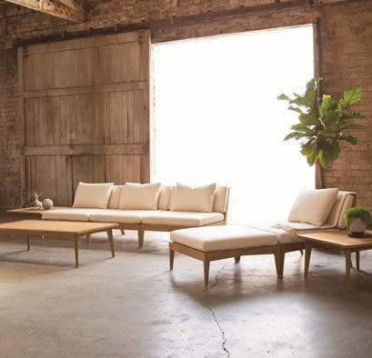 Patio furniture with wood frames and white cushions