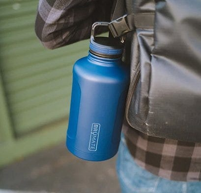 Blue water bottle clipped to backpack