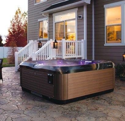 Bullfrog spa with purple lighting and wood panels