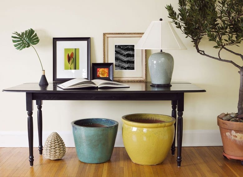 Console table surrounded by decorative items