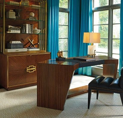 Modern wood desk and display cabinet in home office