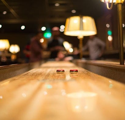 Shuffleboard with two pucks in the middle