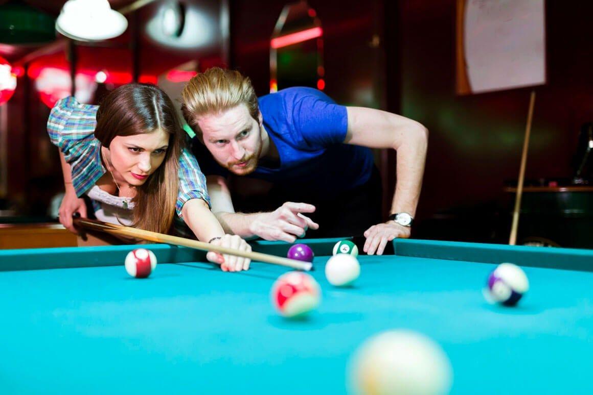 Man and woman playing pool