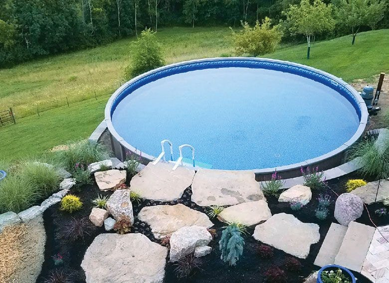 Radiant pool surrounded by landscaping