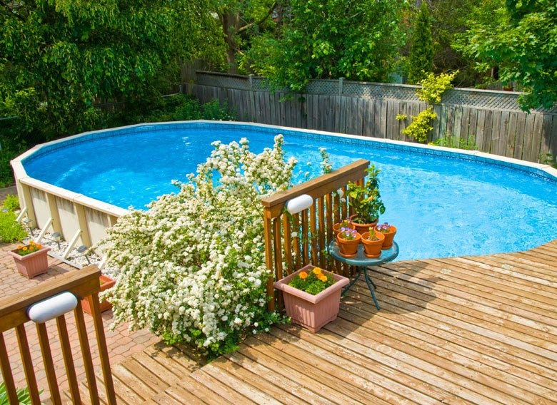 Oval above ground pool with decking