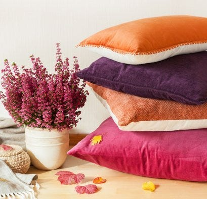 Stack of pillows with flowers