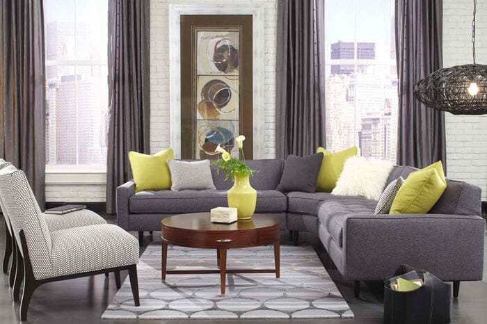Grey Rowe sectional with armchair and coffee table