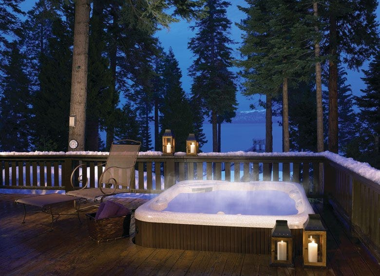 Spa with built-in deck on a snowy landscape